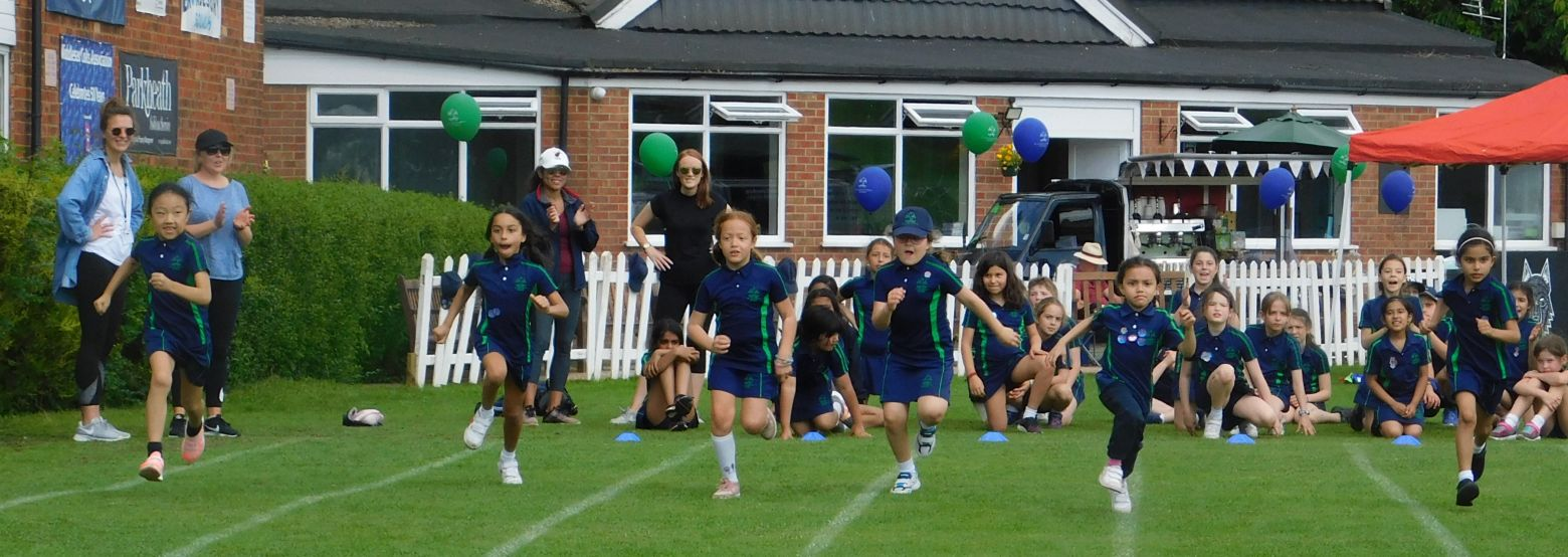 Girls competing on sports day
