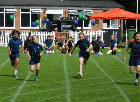 Girls running on sports day 2019