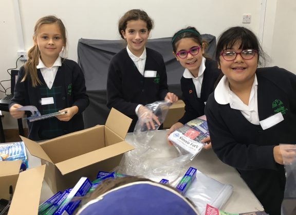 Pupils volunteering on Caritas and Mitzvah Day