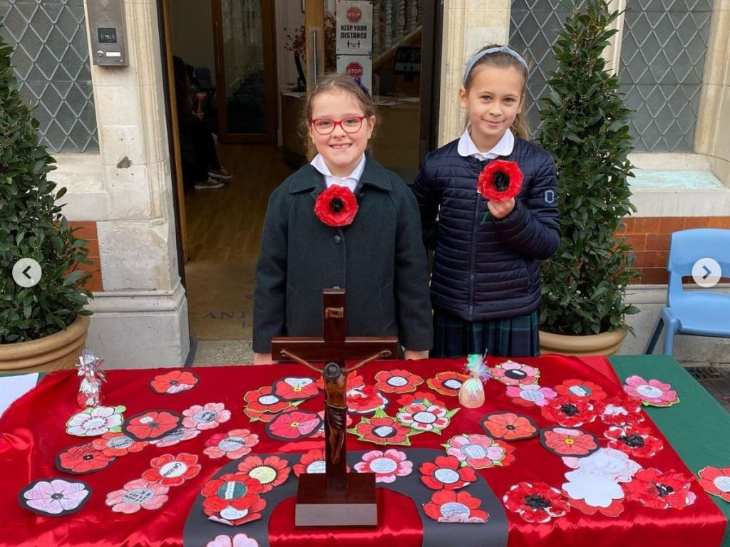 Girls with poppies on Remembrance