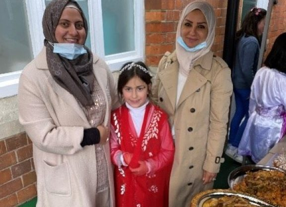 Parents and pupil at school food festival